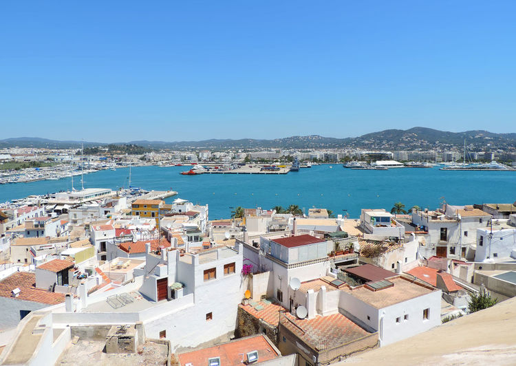 View over Ibiza Town, Dalt Vila view to the harbor of Ibiza. City Cityscape Ibiza Panorama Architecture Blue Building Building Exterior Built Structure City Cityscape Clear Sky Copy Space Dalt Vila Day High Angle View Ibiza Town Nature Outdoors Residential District Sea Sky Town TOWNSCAPE Water