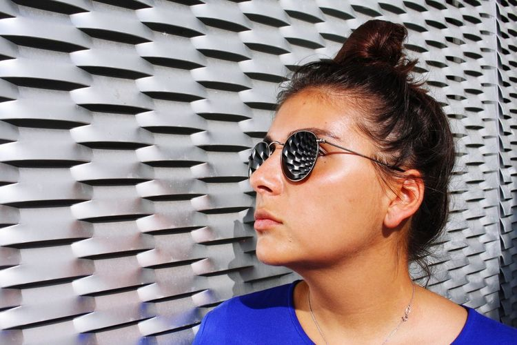 Metal Steel Steel Structure  Reflection Reflections In The Glass Headshot Portrait Real People Glasses Young Adult Lifestyles One Person Young Women Close-up Front View Leisure Activity Fashion Looking Away Women Adult Sunglasses Indoors  Pattern Females Hairstyle Urban Fashion Jungle