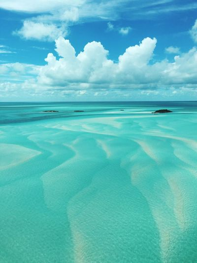 The Exuma Cays Sea Blue Water Tranquil Scene Sky Scenics Tranquility Beauty In Nature Turquoise Colored Cumulus Cloud Calm Travel Photography Aerial Shot Exuma Bahamas A Bird's Eye View