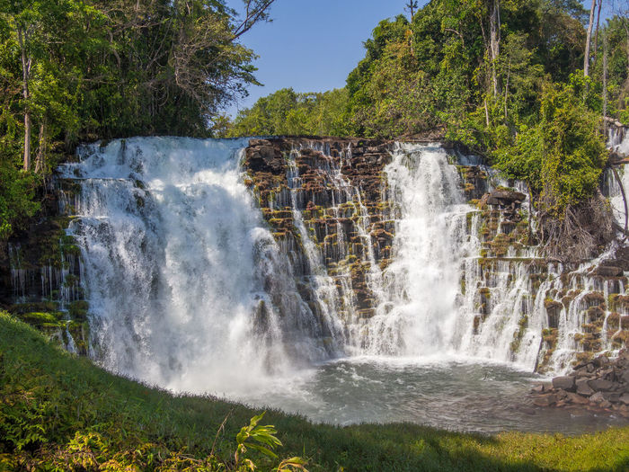 Scenic view of lumangwe waterfall in forest, zambia, africa