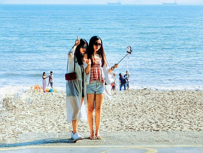 Sea Lifestyles Togetherness Leisure Activity Friendship Beach Standing Casual Clothing Check This Out Young Women Hi! Taking Photos EyeEm Best Shots EyeEm Gallery EyeEm Best Edits Person People And Places Ocean Hello World People People Photography Capture The Moment Selfies Girl Blue