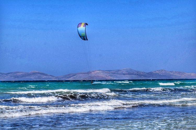 Sea Nature Water Blue Beach Beauty In Nature Wave Day Outdoors Sport Surfing Clear Sky Leisure Activity Vacations Adventure Windsurfing