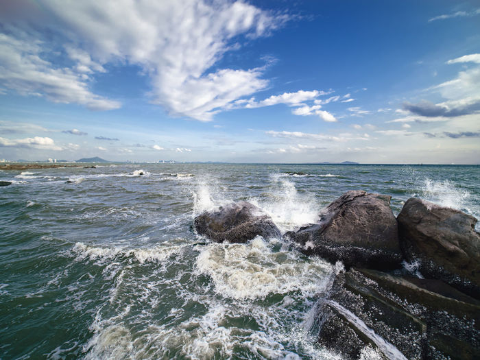 Splashes of the waves bumping against the rocky shore.