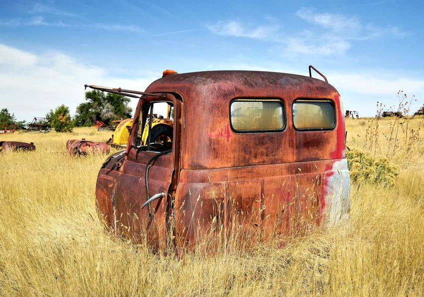 Truck cab Outdoors Clouds And Sky Red Color Deteriorated Junkyard Rusted Old Truck Rural Scene Abandoned Cloud - Sky Bad Condition Weathered