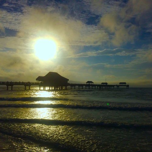 Sun setting over the pier on Clearwater Beach Travel Beach Clearwaterbeach Clearwater Florida Sunset Beachview Sunset Silhouettes Mission: December