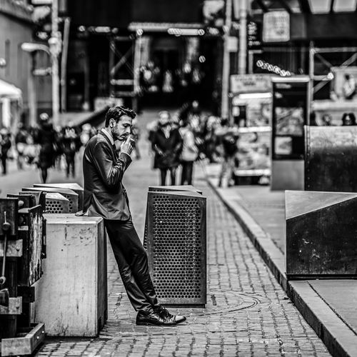 """""""Music and a Cigarette"""" Adult Architecture Blackandwhite Cigarette  Day EyeEm Selects Full Length Lifestyles One Person Outdoors People Real People Standing Fresh on Market 2017 The Street Photographer - 2018 EyeEm Awards The Modern Professional"""
