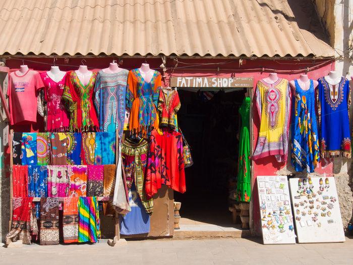 Clothes shop in Santa Maria, Sal Island, Cabo Verde Multi Colored Retail  Market Shopping Retail Display Street Market Textile