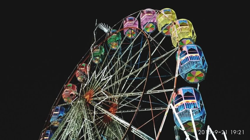 Black Background Ferris Wheel Multi Colored Amusement Park Ride Arts Culture And Entertainment Amusement Park Illuminated Cityscape Climbing Sky