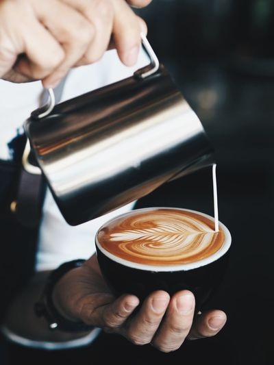 Barista pouring coffee latte art. Barista Cafe Cappuccino Close-up Coffee - Drink Coffee Cup Day Drink Focus On Foreground Food And Drink Freshness Froth Art Frothy Drink Holding Human Body Part Human Hand Indoors  Latte Making Occupation One Person Real People Refreshment Skill