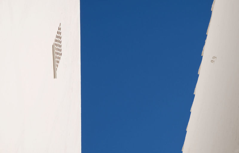 Architecture_collection Blue Building Exterior Clear Sky Copy Space Dark Blue Sky Day High Contrast Lines Lines And Patterns Minimalism Nature No People Outdoors Part Of A Building Sky Spain, Andalucia, Malaga Sunny Day Torremolinos Travel Vertical Lines White Wall The Architect - 2017 EyeEm Awards