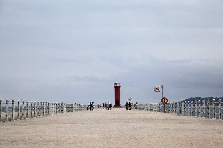 Architecture Built Structure Cloud - Sky Day Donghae, Gangwon Fishing Gangneung Group Of People Guidance Lamp Post Leisure Activity Lifestyles Lighthouse Men Outdoors Person Pier Scenics Sea Seaside Seawall Sky Tranquil Scene Tranquility Weekend Activities
