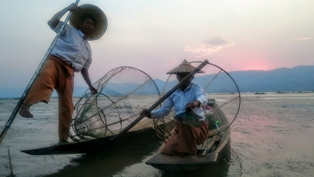 Burma Birma Myanmar Inle Lake Shan State One Leg Rowers Fishermen Fishing Burmese Culture Fishing Boat Sunset Dusk Fishing Nets On The Water Traditional Fisherman Purple Skies Dreamy Mood The Great Outdoors - 2016 EyeEm Awards The OO Mission People And Places TakeoverContrast Let's Go. Together.