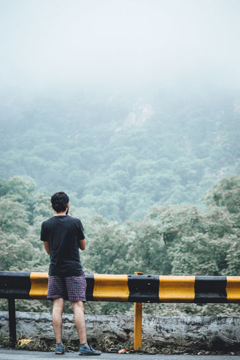 Beauty In Nature Casual Clothing Day Fog Full Length Leisure Activity Lifestyles Looking At View Men Mountain Nature Non-urban Scene One Person Outdoors Real People Rear View Scenics - Nature Standing Tree Young Men My Best Travel Photo
