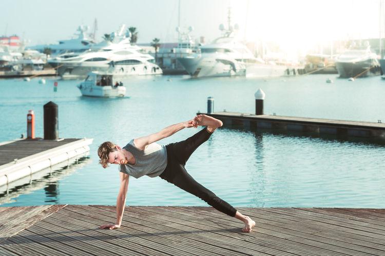 Portrait of woman on pier over sea