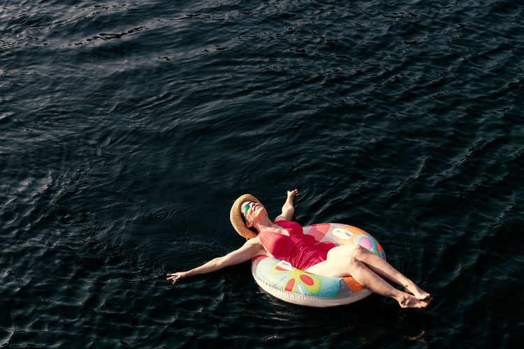Woman on inflatable ring in lake