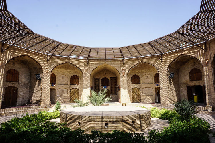 Travel Destinations Travel Photography Iran Shia Community Nomadic Zoroastrian Islamic Architecture Architecture Built Structure Arch Building Exterior Sky History Day Sunlight Religion Plant Belief Place Of Worship Tourism Low Angle View Dome Courtyard  Ancient Civilization Arched