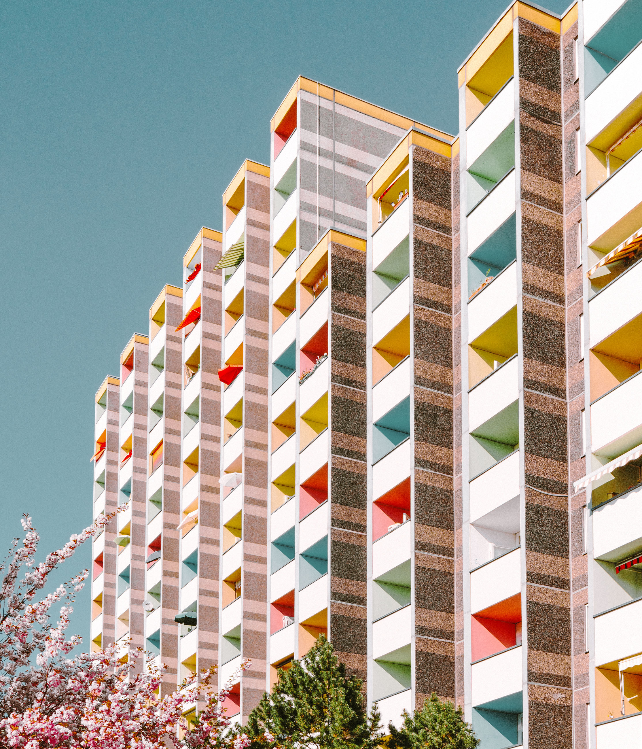 sky, nature, clear sky, no people, architecture, built structure, low angle view, multi colored, blue, building exterior, pattern, day, sunlight, outdoors, plant, shape, striped, tree, modern, city