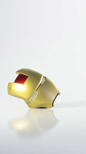 Close-up of yellow object over white background