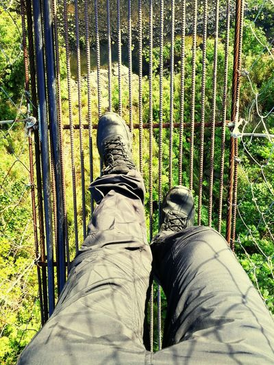 On Hanging Steps | Low Section Human Leg Shoe One Person Day Standing Outdoors Human Body Part Real People One Man Only Nature Close-up People Adult Adults Only Only Men Nature Lover Bridge Scenics Country Side Field Rural Scene Landscape Beauty In Nature Country