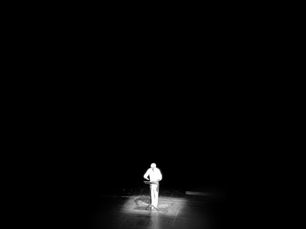 Full Length Illuminated Standing Night Only Men Black And White Photography Actoring Theatrical Performance One Person Attore su un mare di oscurità This Is Aging