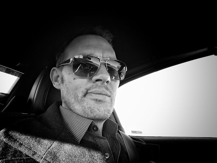 A portrait of a scruffy Englishman (me) One Man Only Headshot Close-up Selfie ✌ Stubblephotography Stubble Reflective Sunglasses Blackandwhite Black And White Photography In A Car Vanity Selfie✌ Monochrome