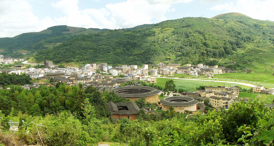 How Do We Build The World? China Fujian, China Tulou Architecture City Cityscapes Architecture_collection Architecturephotography City View  Nature & City Nature And Lanscapes Nature And City Nature And Architecture Chinese Architecture Chinese Building Mountain View Mountain Village