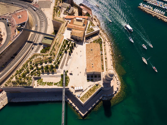Aerial view of buildings by sea