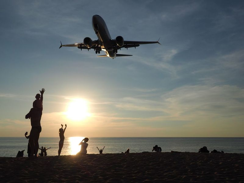 While watching the sunset. Everyone is happy to see the plane at the Phuket Airport. Happy People Happy Happiness Thailand Beachfront Phuket Airport Phuket,Thailand Phuket Airport Sky Water Sea Horizon Beach Flying Nature Air Vehicle Cloud - Sky Airplane Outdoors Travel Beauty In Nature