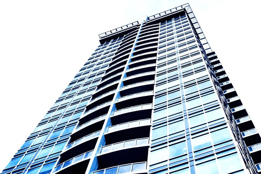 Urbanphotography Skyscraper Tower Living YYC Building Exterior Low Angle View Architecture Built Structure Modern Clear Sky City No People Outdoors