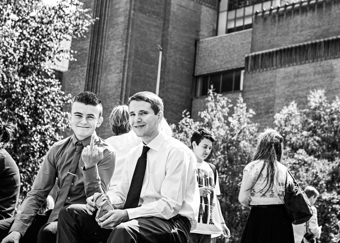 London welcomes you! Black And White Blackandwhite Boys Building Exterior Day Education Friendship Outdoors Real People Sitting Smiling Street Photography Streetphotography Student The Street Photographer - 2017 EyeEm Awards Togetherness Young Adult Young Men