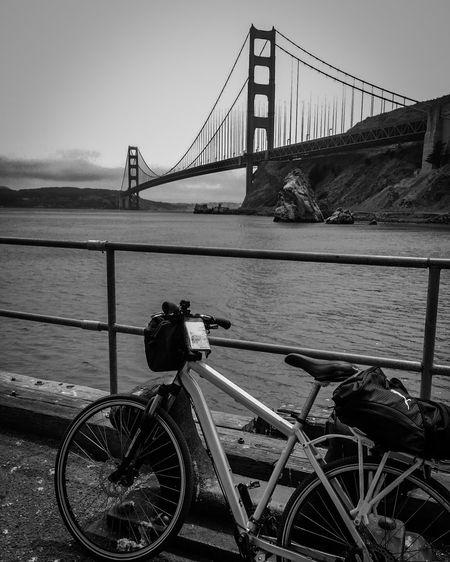 Monochrome Photography Transportation Bicycle Bridge - Man Made Structure Suspension Bridge Sky Water City Tourism Travel Destinations Golden Gate Bridge CyclingUnites