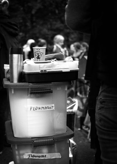 Flohmarkt - Ladybug Black & White Street Photography Black And White Photography Flea Market Text Incidental People Food And Drink Drink One Person Focus On Foreground Communication Food