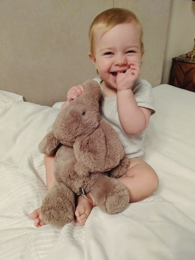 Lellephant love Elephant Cuddles Cyddlebuddys Baby Girl Smile Smiling Smiling Face Smiling Baby  Comfort Bedroom Portrait Smiling Childhood Sitting Full Length Cheerful Happiness Bed Cute Stuffed Toy Toy Teddy Bear Animal Representation Toddler  Unknown Gender Babyhood Toy Animal Baby Clothing Diaper