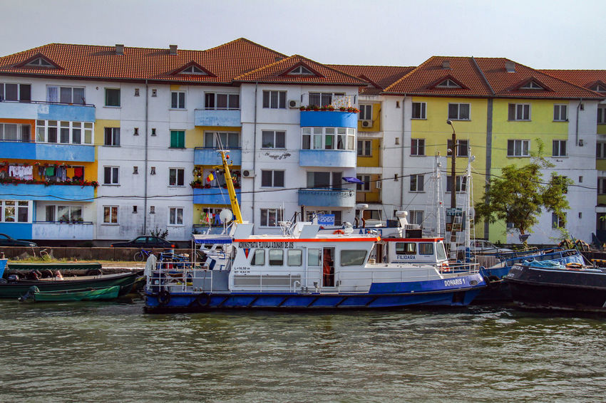 Danube Delta Danube Architecture Boat Building Exterior Built Structure City Clear Sky Day Mode Of Transport Moored Nature Nautical Vessel No People Outdoors Residential Building River Sky Transportation Water Waterfront Waterway To Sulina
