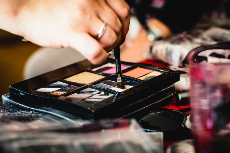 Fashion Makeup Set Woman Applying Beauty Brush Close-up Cold Temperature Collection Cosmetics Human Hand Indoors  Make Up Make Up Artist Occupation Product Selective Focus Shadow