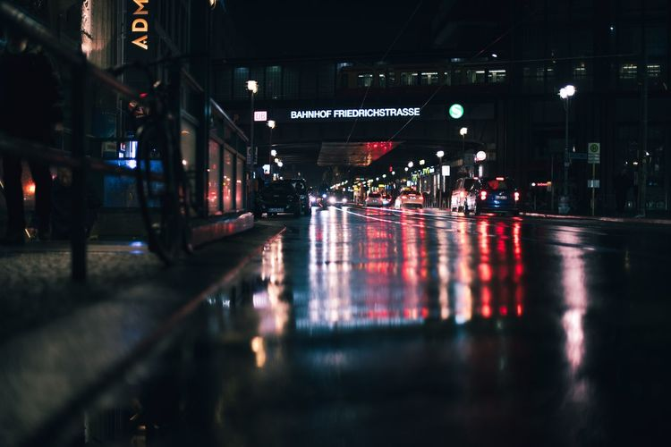 Surface level of wet city street at night
