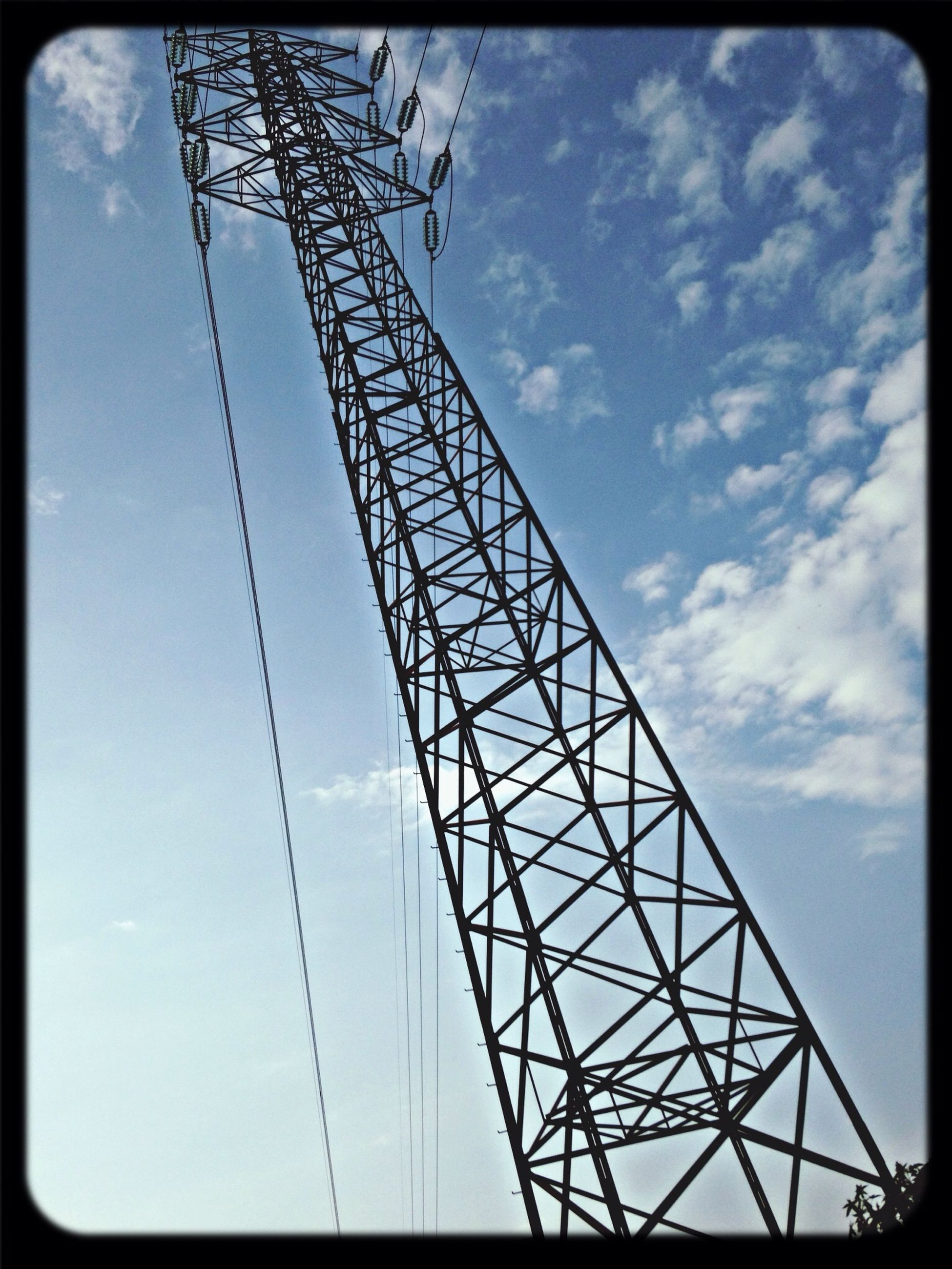 transfer print, low angle view, sky, auto post production filter, electricity pylon, connection, power line, power supply, electricity, cloud - sky, technology, built structure, metal, cable, cloud, silhouette, fuel and power generation, day, outdoors, no people