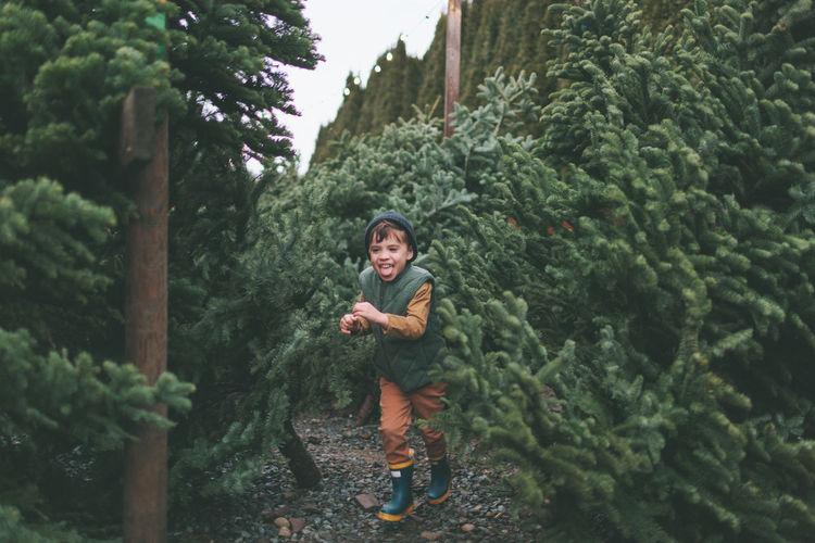Boy running amidst plants