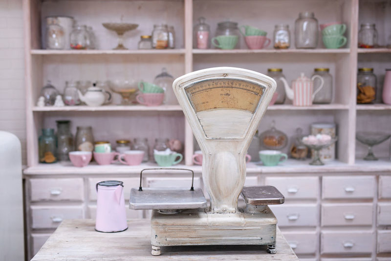 Close-up of weight scale on table