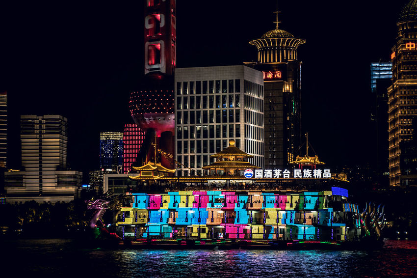 Building Exterior Architecture Built Structure Night Water City Building Illuminated Waterfront Travel Destinations Multi Colored Office Building Exterior Transportation No People River Nature Nautical Vessel Text Urban Skyline Skyscraper
