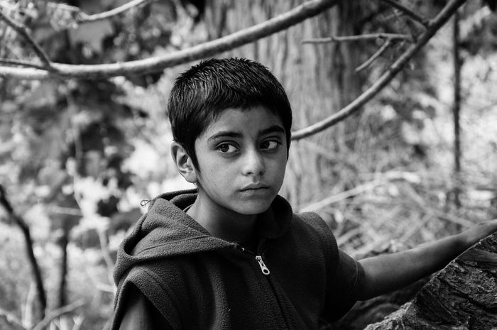Untold Stories Dard People THE DARD PEOPLE [9] The only genuine Dard ethnic group left in the world can be found in the Dah-Hanu Valley, along the Indus River, in Ladakh, Jammu Kashmir. It is a community of some 700 hundred people living in complete autarchy thanks to their thriving agriculture. Isolated along the centuries and practising endogamy, this Indo-Aryan community, whose facial features are typical and easily identifiable, has managed to keep all traditions alive. They are the only Buddhist dard community left (the others are Muslim) and still wear distinctive jewels and hats made of flowers and fruit. The Dah-Hanu Valley, where the brokpa (as dards are called by ladakhi people) villages are, is situated along a military road and can be visited requesting special permission. In this picture, a portrait of a child buddhist monk. Ladakh Jammu And Kashmir The Photojournalist - 2015 EyeEm Awards Documentary Photography Photojournalism Claudia Ioan NEM Black&white Black And White People And Places