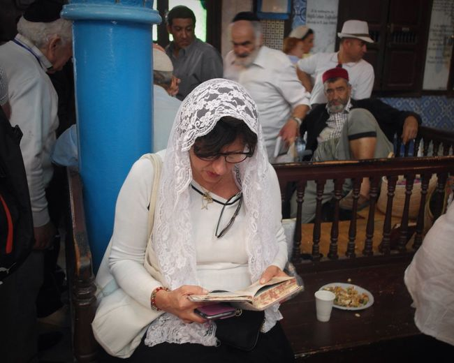 The Photojournalist - 2017 EyeEm Awards Synagogue Woman Praying Jewish Religion Pilgrimage North Africa Portrait Of A Woman Sitting Community Focus On The Story
