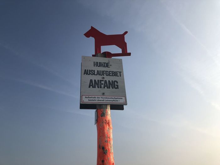 Beach Sign Communication Dog Dog Sign Guidance Information Sign Low Angle View Pole Sign St Peter Ording Text