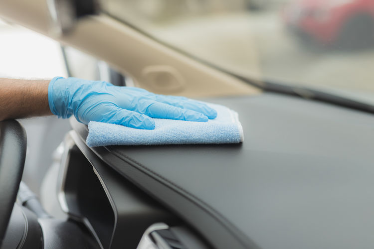 Close-up of human hand on car