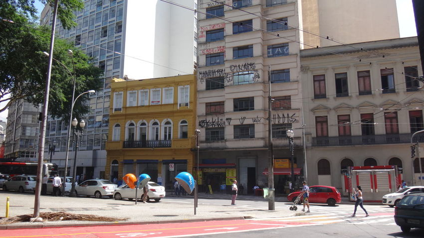 CAIXA CULTURAL PRACA DA SE SAO PAULO BRAZIL Architecture Building Building Exterior Built Structure Car City City Life City Street EyeEm Team Incidental People Land Vehicle Lifestyles Men Mode Of Transport Person Road Street Transportation Tree Walking