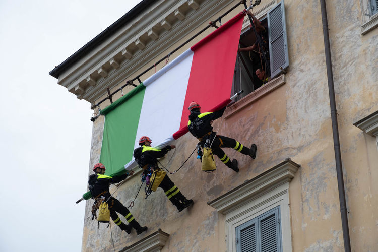 A day dedicated to firefighters in Italy EyeEm Streets Firefighter Italia National Architecture Building Building Exterior Built Structure Celebration Event Communication Eyeem Streetphotography Flag Hanging Italy Low Angle View Outdoors Residential District Streetphotography Wall - Building Feature