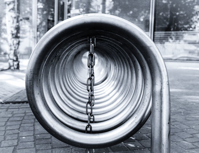 parking place ... Bicycle Rack Built Structure Bycicle Parking City Close-up Fahrradständer Focus On Foreground Kette Metal Metallic Monochromatic Monochrome No People Outdoors Railing Reflection Spiral Spirale Street Transportation Urban Urban Geometry