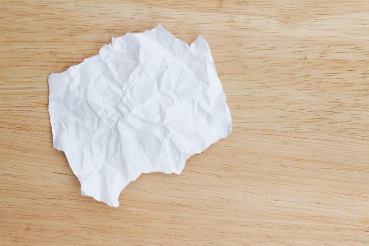 A piece of crumpled white paper on wooden background Torn Paper Background Paper Crumpled Paper Piece Of Paper Wooden Background White Paper Copy Space Copyspace Crumpled Paper Paper Crumpled Table Wood - Material Directly Above Close-up Garbage Torn