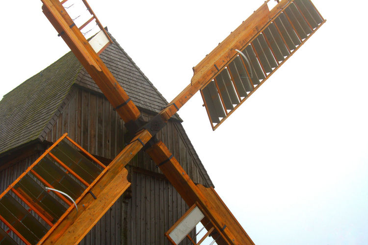Alternative Energy Architecture Building Exterior Built Structure Day Environmental Protection From Underneath Low Angle View Nature No People Outdoors Sky Windmill Windmill Of The Day