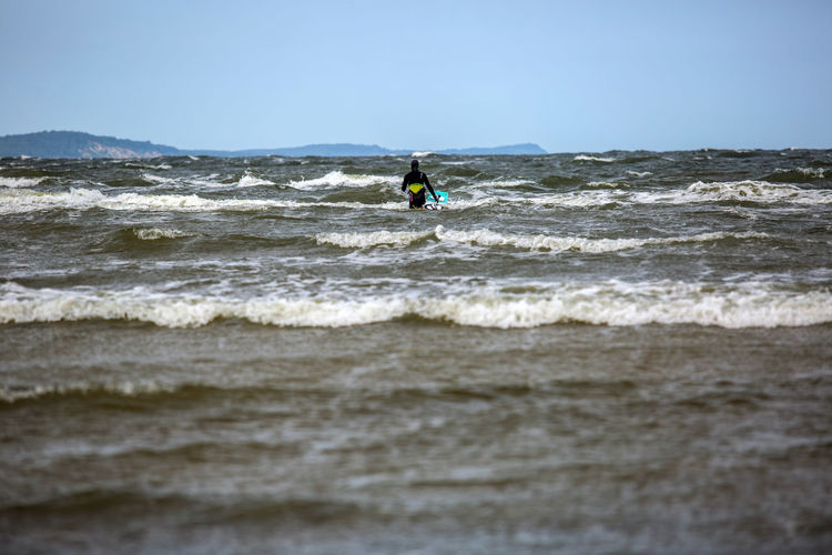 Baltic Baltic Sea Activity Adventure Aquatic Sport Balance Beauty In Nature Bright Extreme Sports Kiteboarding Leisure Activity Motion Nature Outdoors People Recreational Pursuit Sea Skill  Sky Sport Sports Activity Surfboard Surfing Water Wave